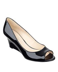3928bf0b73ad Lyst - Nine West Relaxxin Peep Toe Wedges in Black