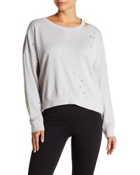 Betsey Johnson - White Distressed Slit Knit Pullover - Lyst