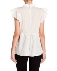 Haute Rogue - White Embroidered Ruffled Top - Lyst