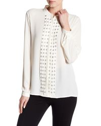 Romeo and Juliet Couture White Grommet Accented Panel Blouse