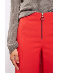 TOPSHOP | Red Frill Zip Palazzo Trousers | Lyst