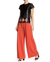 Nicole Miller | Orange Skyscraper Crepe Pleated Pant | Lyst