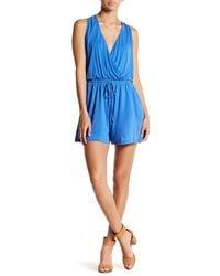 Lush | Blue Surplice Front Tie Romper | Lyst