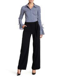 Trina Turk | Black Elfi Pleated Skirt Overlay Short | Lyst