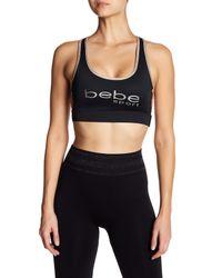Bebe - Black Metallic Caged Logo Sports Bra - Lyst
