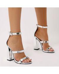 b1b5ca1e498 Public Desire. Women s Oyster Triple Strap Flared Block Heels In Silver