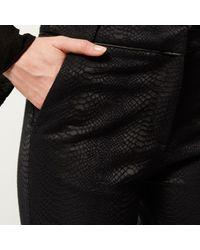 River Island - Black Snake Print Flare Trousers - Lyst