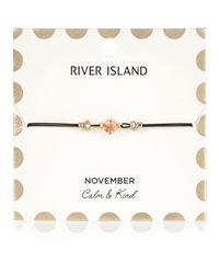 River Island - Black Orange November Birthstone Bracelet - Lyst