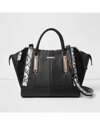 9452a41b53 Lyst - River Island Black Dipped Top Winged Tote Bag in Black