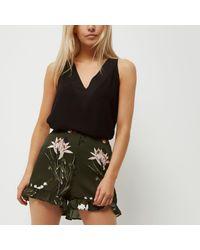 River Island | Petite Khaki Green Floral Print Frill Shorts | Lyst