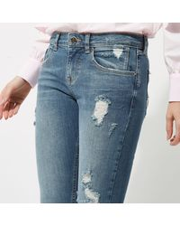 River Island Mid Blue Alannah Ripped Relaxed Skinny Jeans