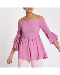 40f6405e09c36 Lyst - River Island Shirred Bardot Frill Sleeve Top in Pink