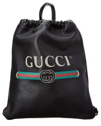 Gucci Black Logo Print Leather Drawstring Backpack for men