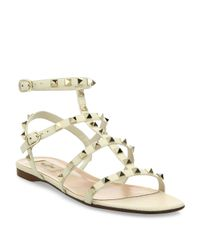 9448ca1df61 Lyst - Valentino Rockstud Leather Flat Sandals in White
