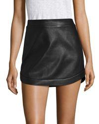 BCBGMAXAZRIA | Black Kanya Curved Hem Leather Mini Skirt | Lyst