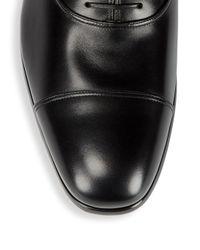 Ferragamo Black Cap Toe Leather Dress Shoes for men