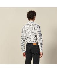 Chemise imprimée papier journal Sandro pour homme en coloris White