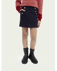 Mini jupe en jersey de coton avec boutons Scotch & Soda en coloris Blue