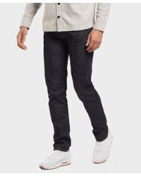 Lacoste Blue Slim Stretch Denim Tapered Jeans for men