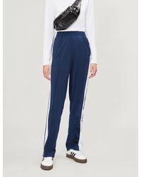 adidas Originals. Women s Blue Adibreak Side-stripe Stretch-jersey jogging  Bottoms 5bc344f1e408
