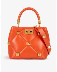 Valentino Garavani Orange Roman Stud Small Leather Top-handle Bag