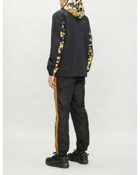 A Bathing Ape Yellow Shark Camouflage-print Hooded Shell Jacket for men