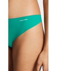 Calvin Klein - Green Invisibles Thong - Lyst