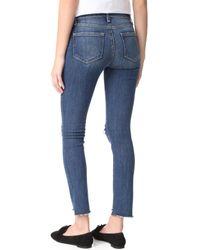 PAIGE Blue Hoxton Ankle Peg Jeans With Uneven Hem