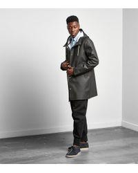 Stutterheim Black The Stockholm Raincoat for men