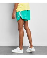 Adidas Originals Green Cali Football Shorts for men