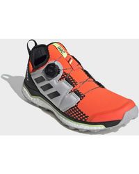 Chaussures Chaussure de trail running Terrex Agravic Boa Adidas pour homme en coloris Orange