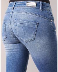 ONLDYLAN femmes Jeans skinny en bleu ONLY en coloris Blue