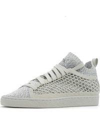 PUMA Lage Sneakers Netfit Evoknit in het Gray