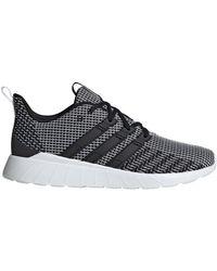 Baskets basses Questar Flow Adidas pour homme en coloris Black