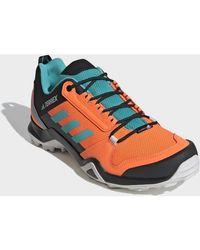 Chaussure de randonnée Terrex AX3 Chaussures Adidas pour homme en coloris Orange