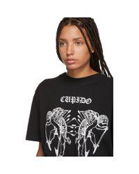 T-shirt noir Cupido Tattoo Marcelo Burlon en coloris Black