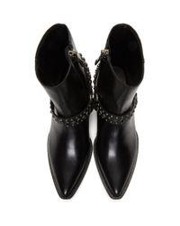 Amiri Black Studded Harness Boots for men