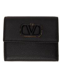 Portefeuille a trois volets noir Mini VSling Garavani Valentino Garavani en coloris Black
