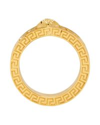 Anneau dore Medusa Versace pour homme en coloris Metallic