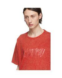 T-shirt orange Rubber Logo edition Yves Scherer Rochambeau pour homme