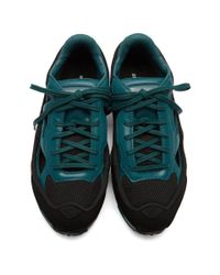 Raf Simons Blue And Black Adidas Originals Limited Edition Replicant Ozweego Sneakers Anniversary Pack for men
