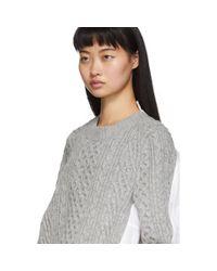 Pull en maille de laine gris et blanc Sacai en coloris Gray