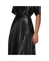 Jupe plissee enduite noire MM6 by Maison Martin Margiela en coloris Black