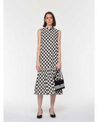Roman Black Polka Dot Flounce Sheath Dress