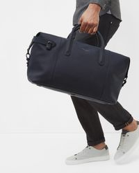Ted Baker Blue Rubberised Leather Holdall for men