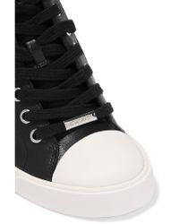 DKNY - Black Cindy Laser-cut Leather Wedge Sneakers - Lyst