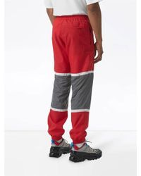 Burberry Red Logo Graphic Striped Nylon Trackpants