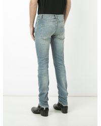 Saint Laurent Blue Studded Distressed Jeans for men