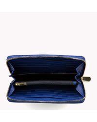 Tommy Hilfiger Blue Zip Around Monogram Wallet