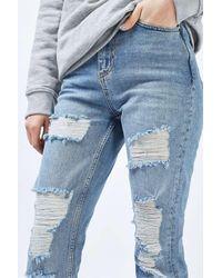 TOPSHOP - Blue Moto Bleach Super Ripped Straight Leg Jeans - Lyst